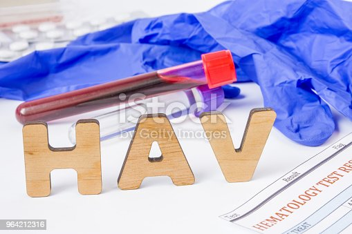 istock HAV Medical acronym or abbreviation of hepatitis A virus in laboratory test diagnostics and physical diagnosis. Word HAV is near blood sample in lab tube, protection glove, blood test and medications 964212316