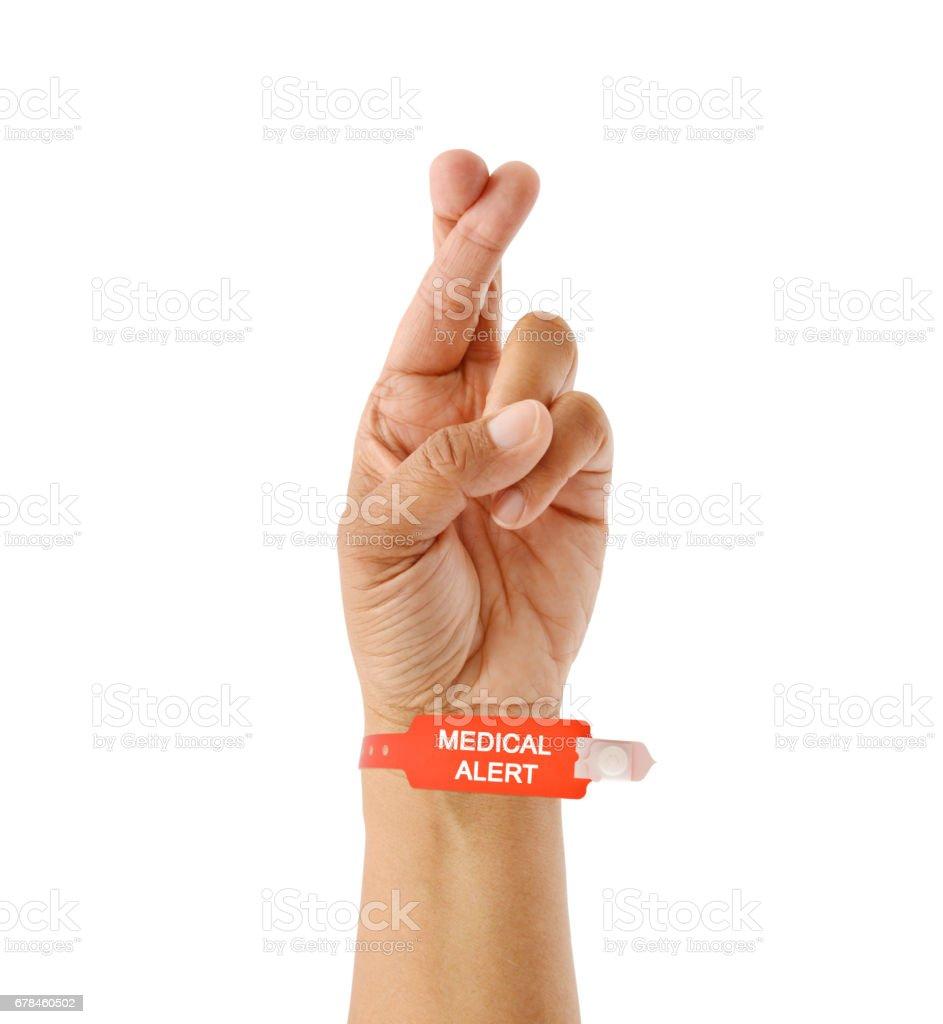 Medical Alert Bracelet Fingers Crossed royalty-free stock photo