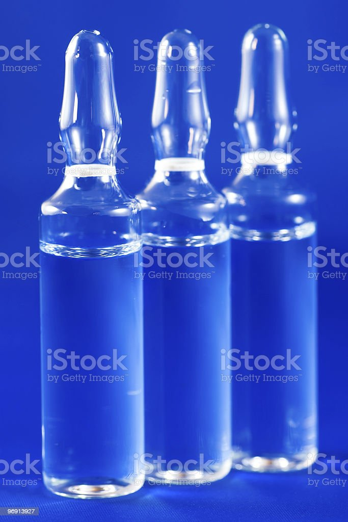 Medical ampules with medicine on a blue background royalty-free stock photo