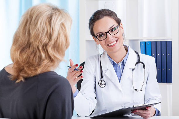 Medical appointment in doctor's office stock photo