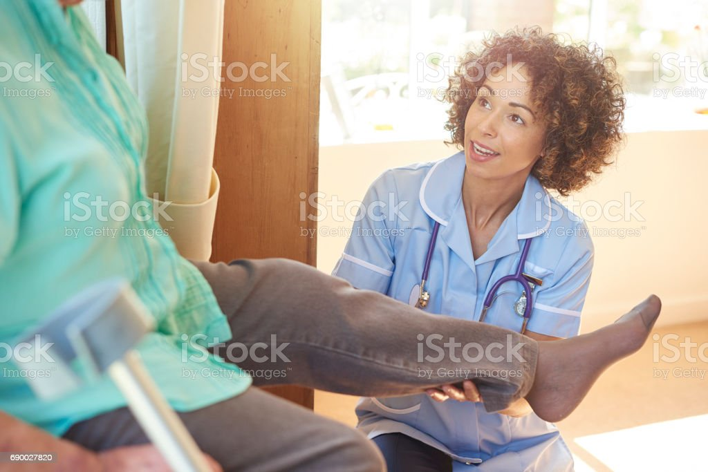 medical assessment at home stock photo