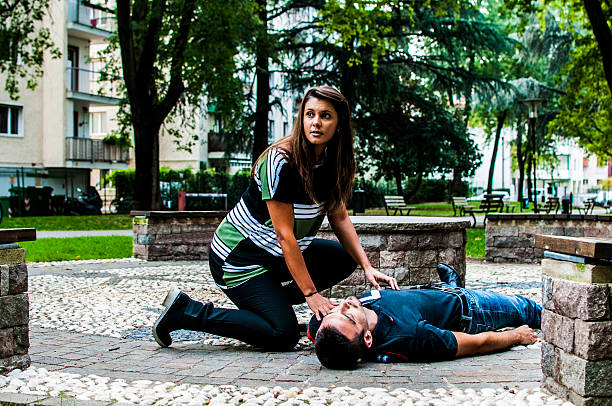 Medical assistance First aid in the park stranger stock pictures, royalty-free photos & images