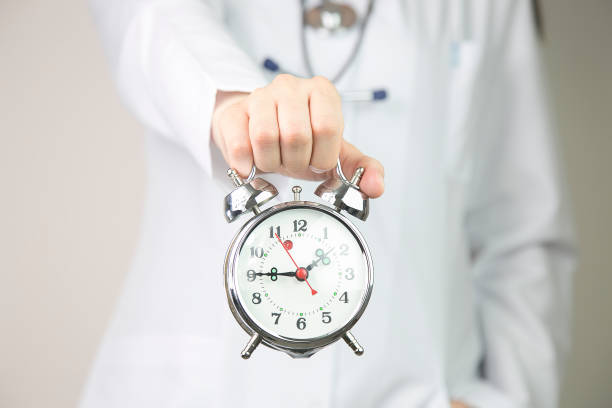 Medical background doctor with clock. Health and detox concept stock photo