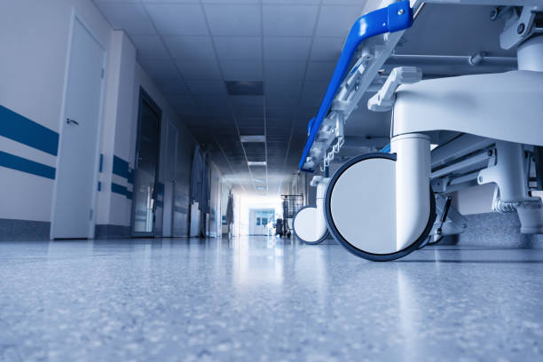 Medical bed on wheels in the hospital corridor. stock photo