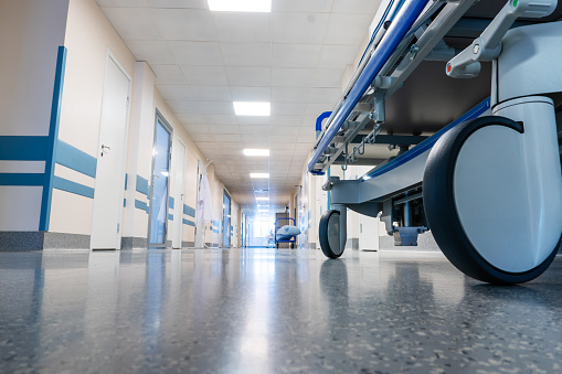 Medical bed on wheels in the hospital corridor. View from below.