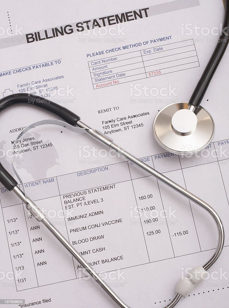 Medical bill with a stethoscope placed on it stock photo
