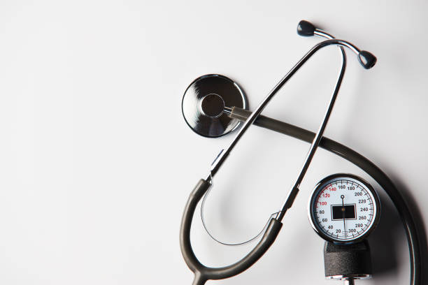 Medical Blood Pressure device and medical stethoscope Medical Blood Pressure device and medical stethoscope on white background with copy space, top view. Healthcare concept hypertensive stock pictures, royalty-free photos & images