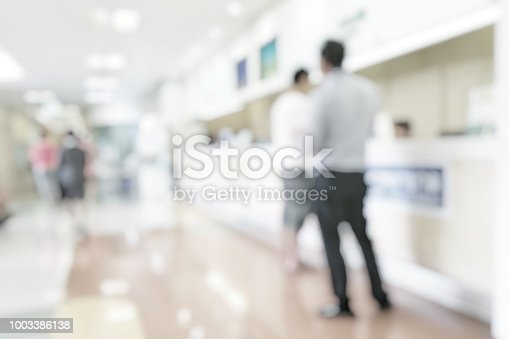 istock Medical blur background customer reception or patient service counter, office lobby in hospital clinic, or bank business building blurry interior inside waiting hall area 1003386138