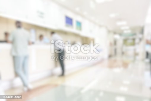 istock Medical blur background customer reception or patient service counter, office lobby in hospital clinic, or bank business building blurry interior inside waiting hall area 1006940992