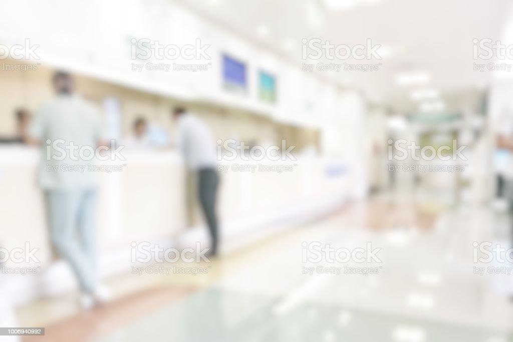 Medizinische Unschärfe Hintergrund Kunde Empfang oder Patient Service-Counter, Büro Lobby in Klinik oder Bank Business verschwommenen Gebäudeinneren in Halle Wartebereich – Foto