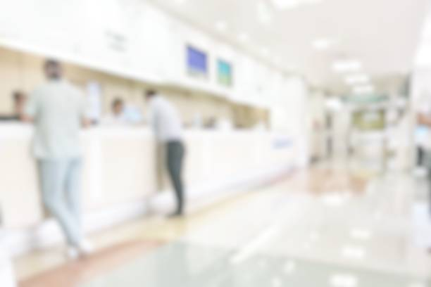 medical blur background customer reception or patient service counter, office lobby in hospital clinic, or bank business building blurry interior inside waiting hall area - high key stock pictures, royalty-free photos & images