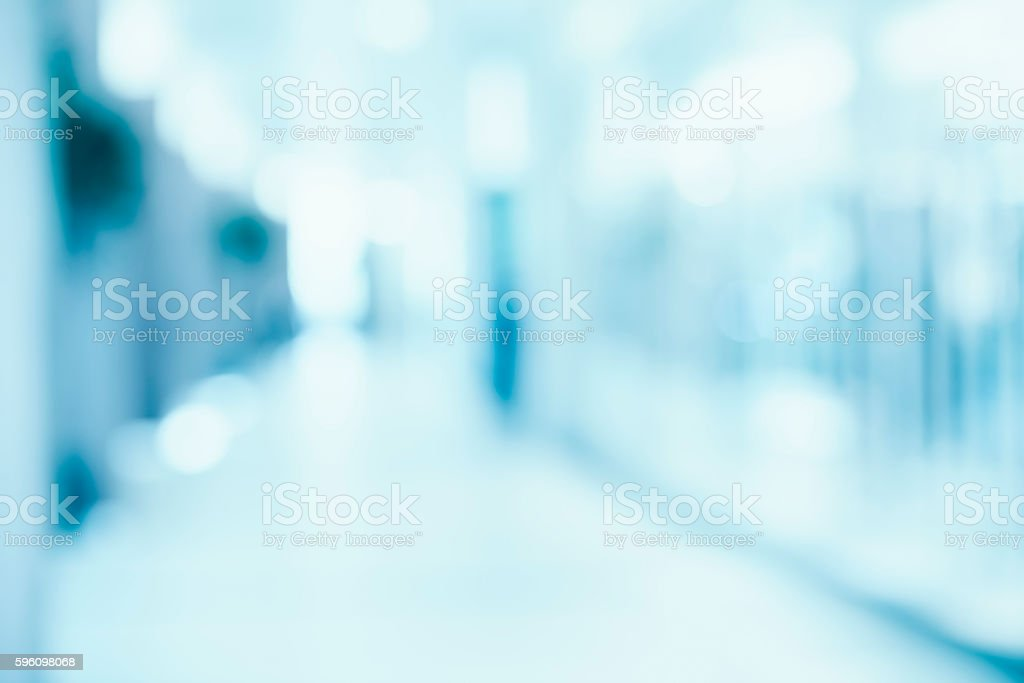 medical blurred background, empty hospital corridor in neon blue​​​ foto