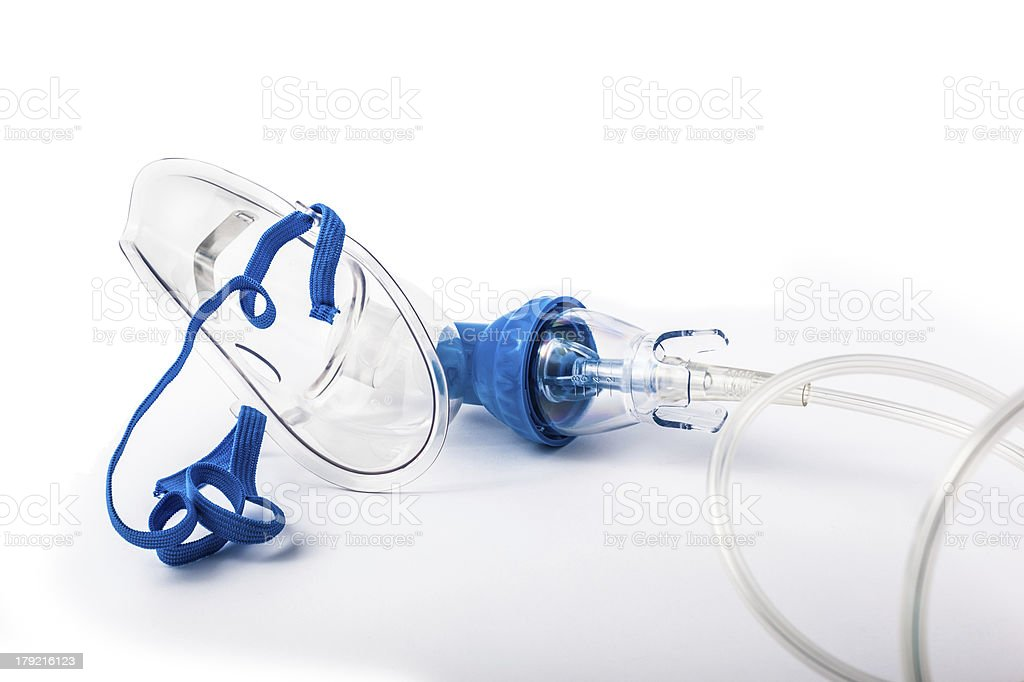 A medical breathing mask laying on a white background  stock photo