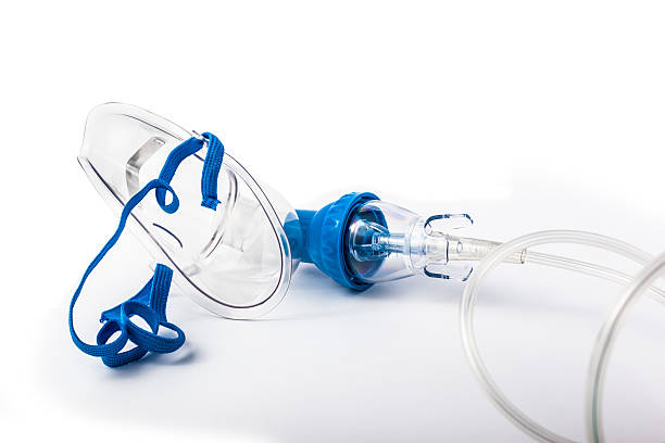 A medical breathing mask laying on a white background  a medical oxygen mask isolated over a white background oxygen mask stock pictures, royalty-free photos & images