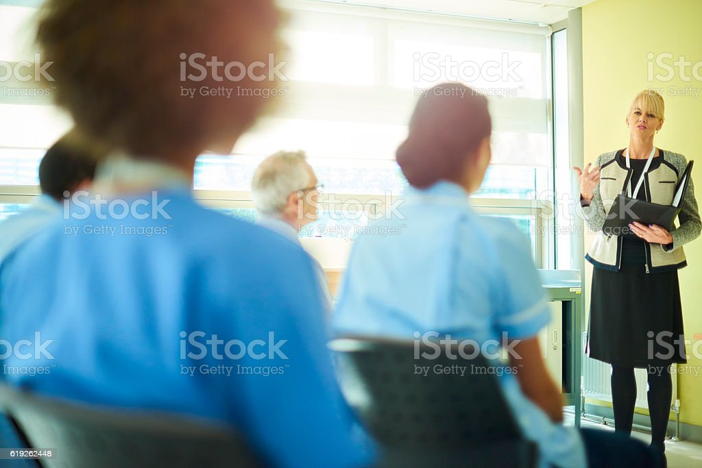 medical team hear presentations from business in the hospital board...