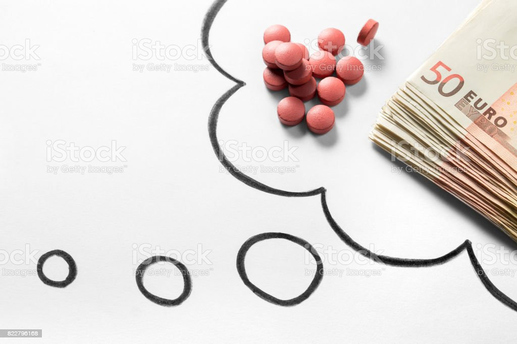 Medical business or prices concept. Thinking about money in pharmaceutical industry or high medical expenses. Also drug dealing, dealer or trade. Drawn thought bubble with pills and money. stock photo