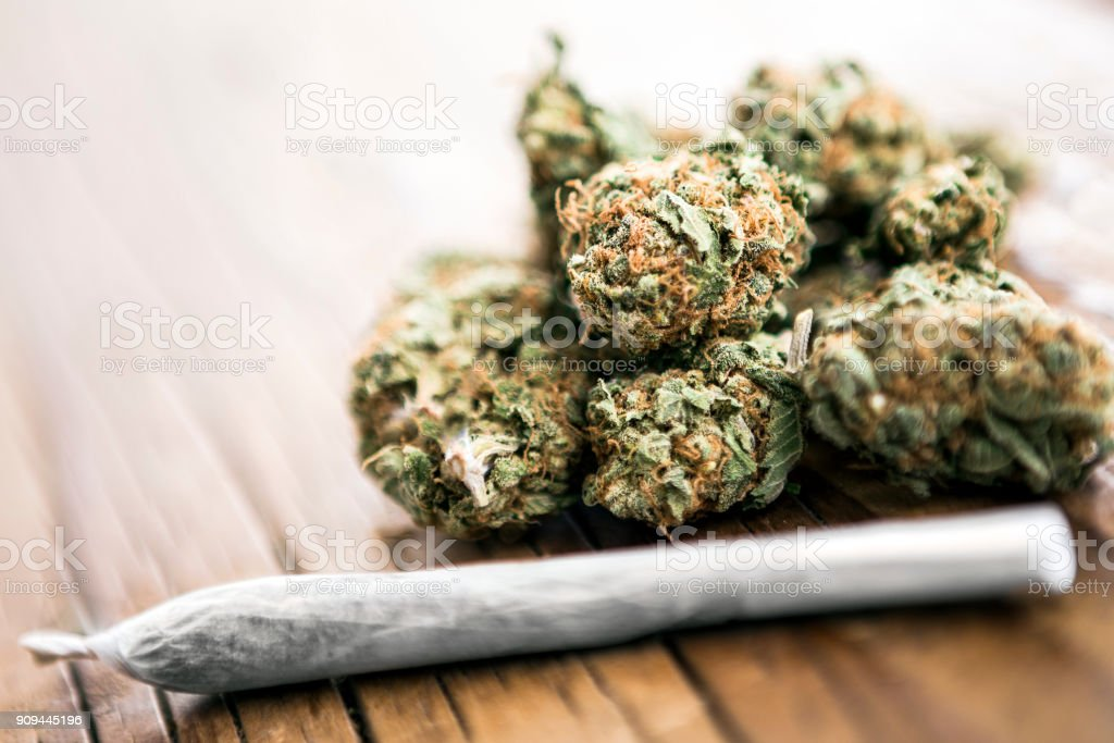 Medical cannabis joint on cannabis buds stock photo