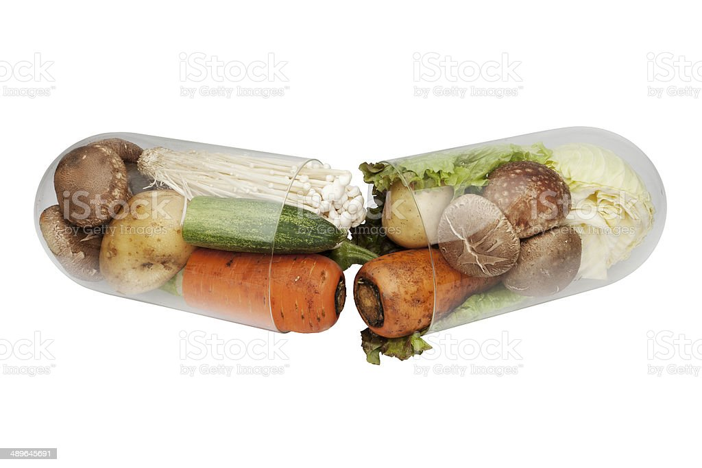 medical capsule in vegetable stock photo