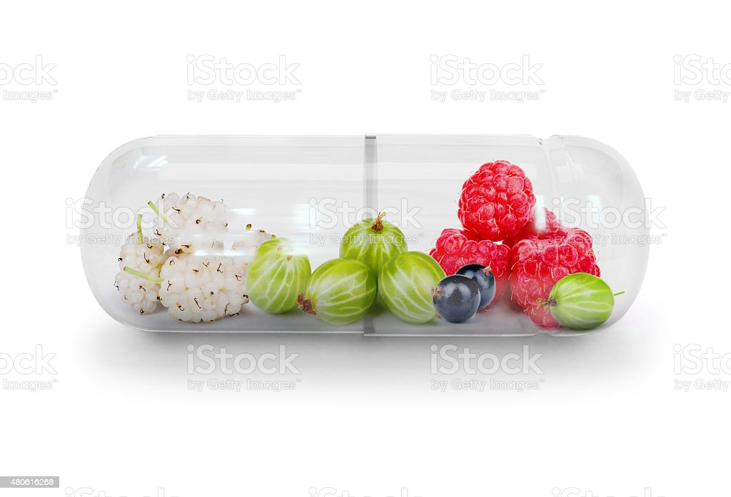 Medical capsule with berries stock photo