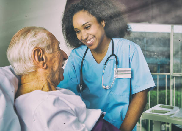 medical care  concept. nurse assisting patient in hospital - psychiatric ward stock photos and pictures