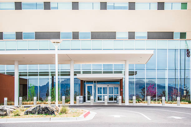 medical center hospital modern building facade - hospital building stock photos and pictures