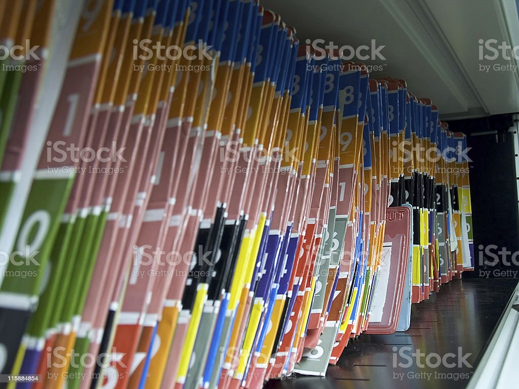 Medical chart folders organized by numbers on shelf stock photo