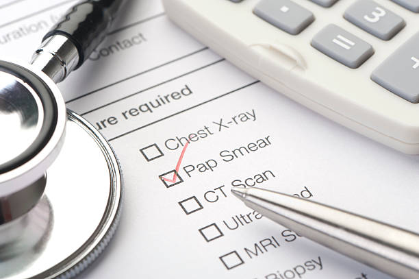 """Medical chart, pap smear ticked """"Medical chart, pap smear ticked with stethoscope and pen"""" pap smear stock pictures, royalty-free photos & images"""
