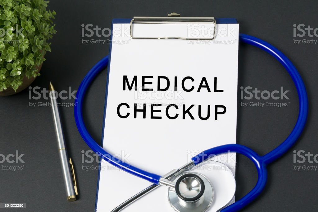 Medical Checkup Word on Paper with Stethoscope royalty-free stock photo