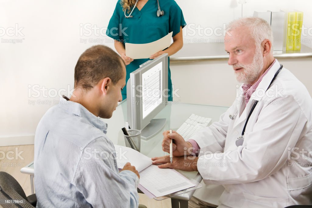 Medical Clinic Appointment with Patient and Doctor royalty-free stock photo