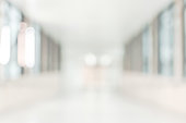 Medical clinic blur background healthcare hospital service center in patient's ward blurry perspective view of interior white room, lab corridor hallway, lobby or walkway for nursing care service facility