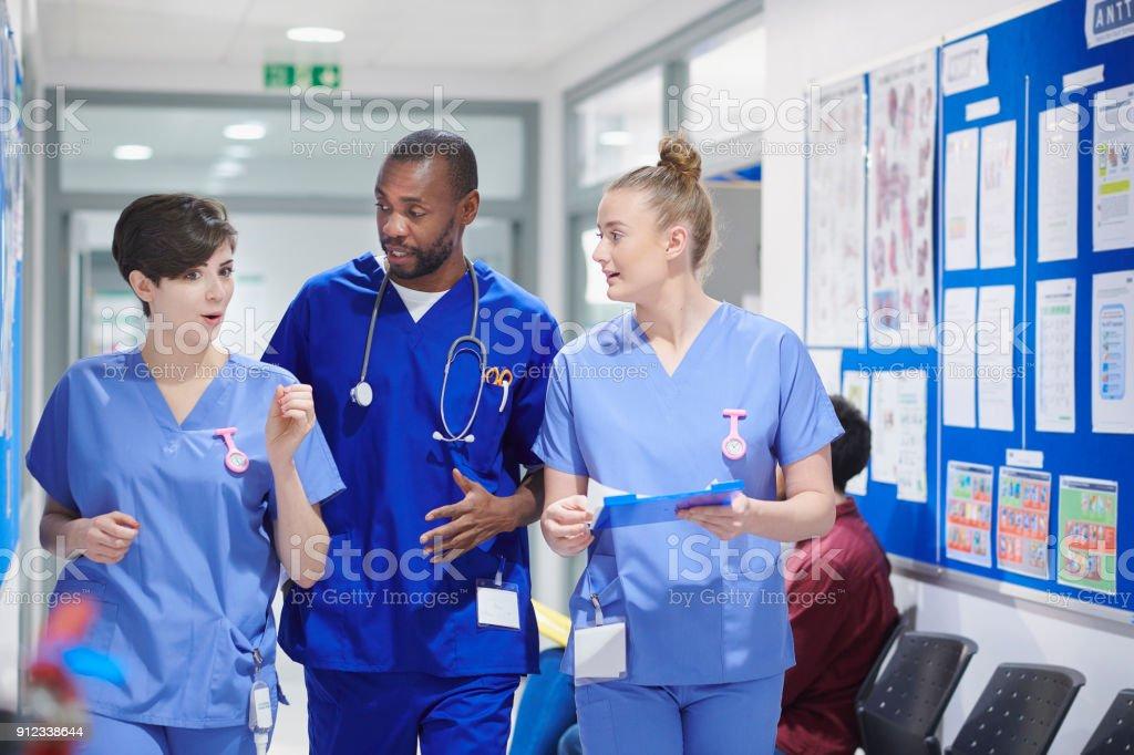 medical clinic team walking stock photo
