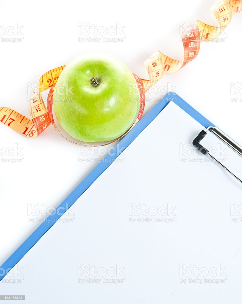 Medical clipboard, tape  and apple isolated on white background royalty-free stock photo