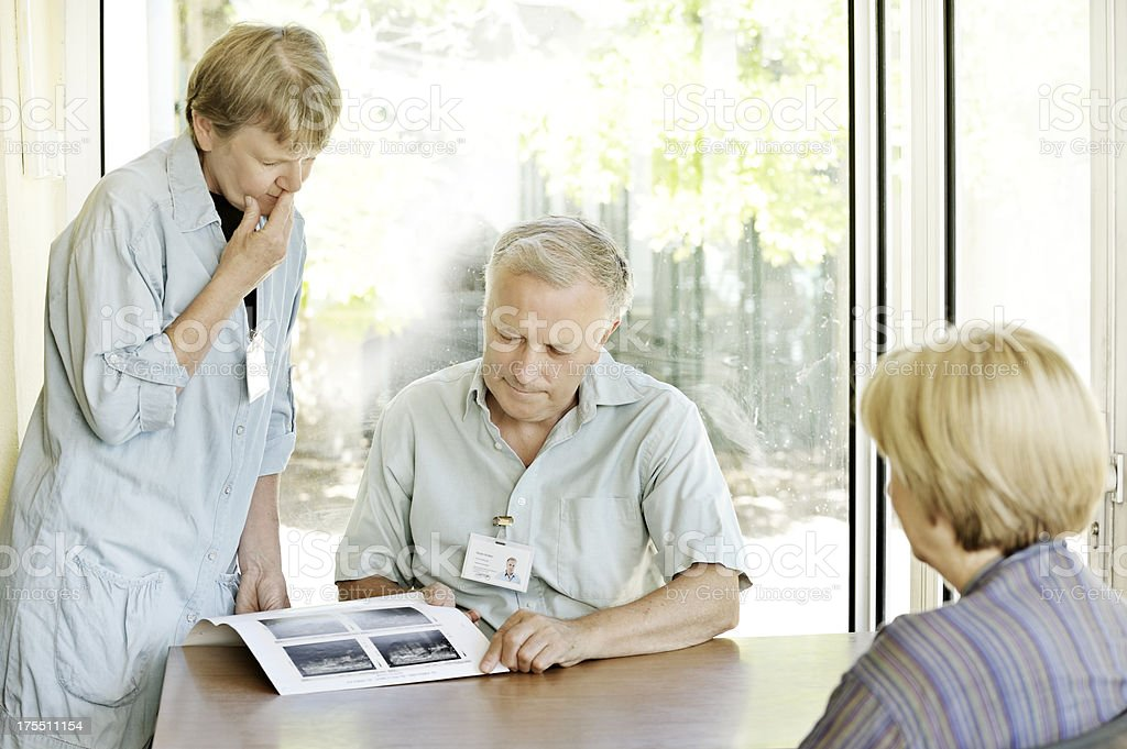 Medical colleagues discuss scans with patient stock photo