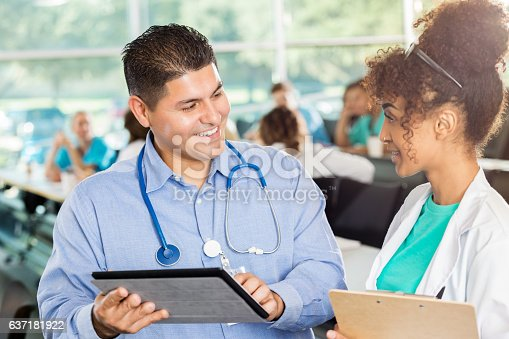 istock Medical colleagues use digital tablet to review patient medical record 637181922