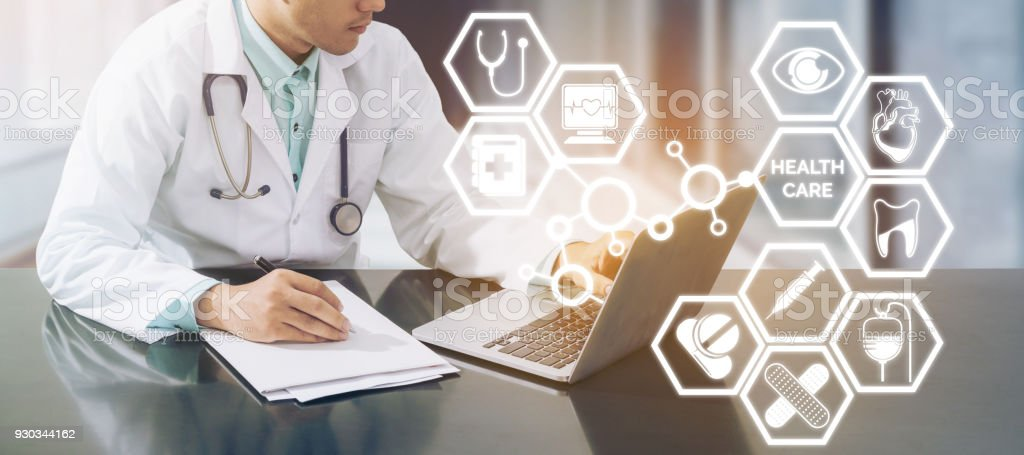 Medical concept - Doctor on Computer with Icons stock photo