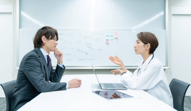 medical consultation concept. occupational health physician. - asia orientale foto e immagini stock