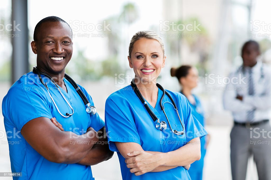 medical co-workers with arms crossed stock photo