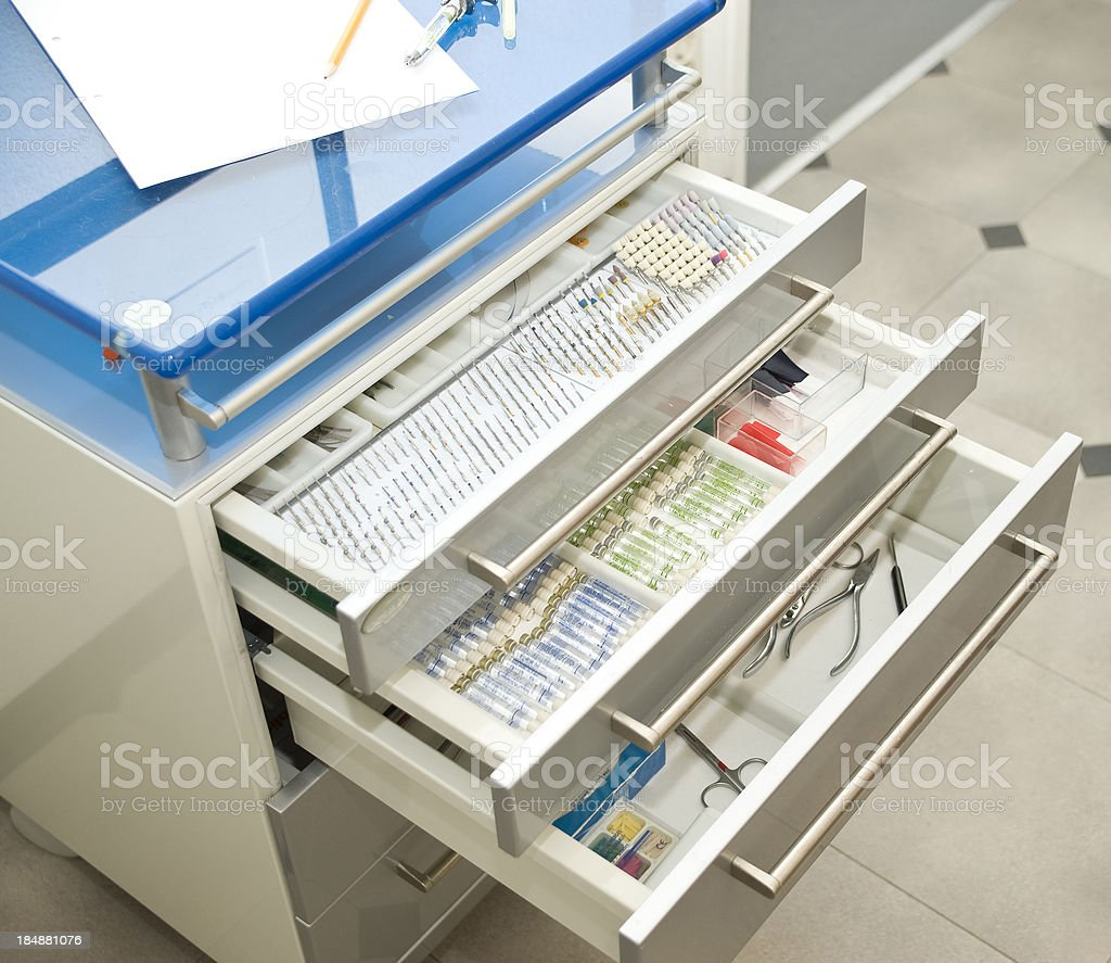 medical dentist equipment in open drawer royalty-free stock photo