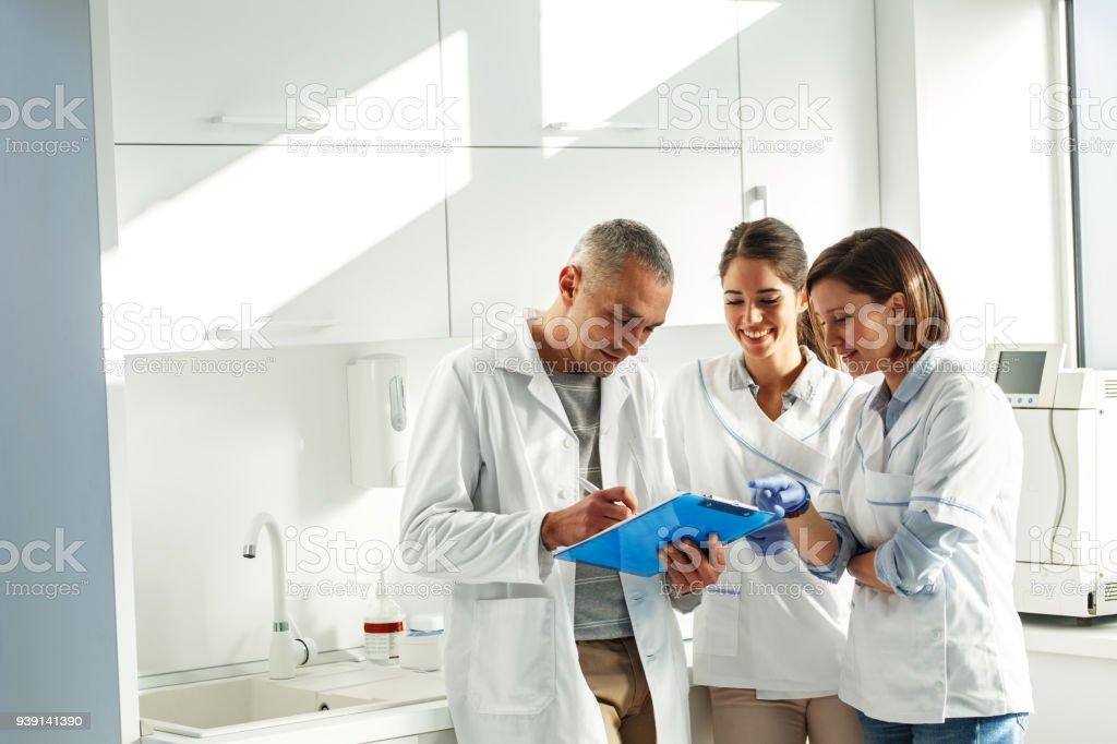Medical dentist team in dental office stock photo