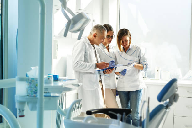 Medical dentist team in dental office stock photo
