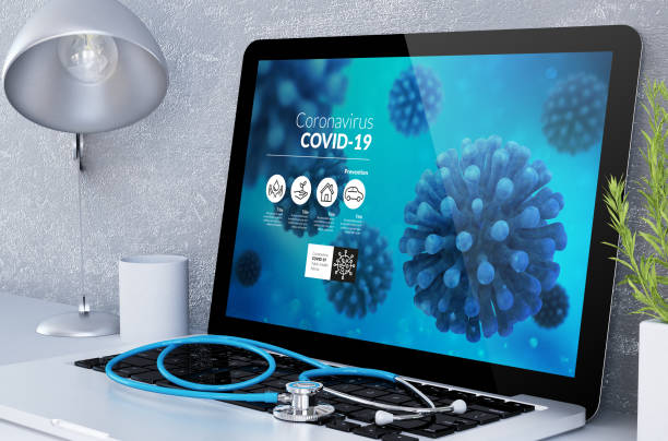 medical desktop computer with covid-19 info stock photo