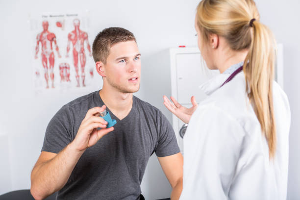 Medical doctor applying oxygen treatment on a sporty men stock photo