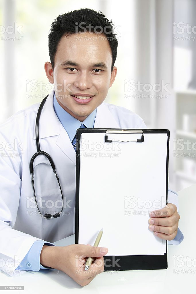 medical doctor showing blank clipboard royalty-free stock photo