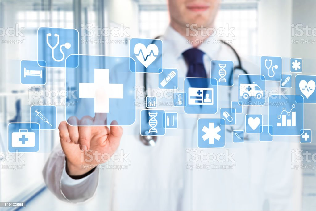Medical doctor showing icons of healthcare services, hospital background stock photo