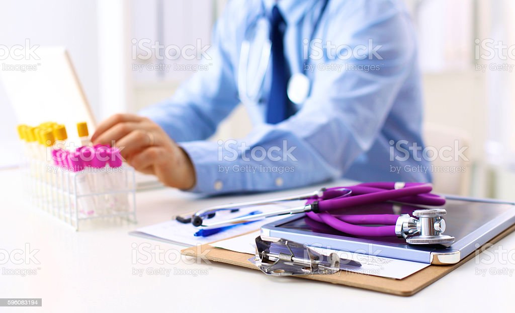 Medical doctor sitting at table and looking patients roentgen royalty-free stock photo