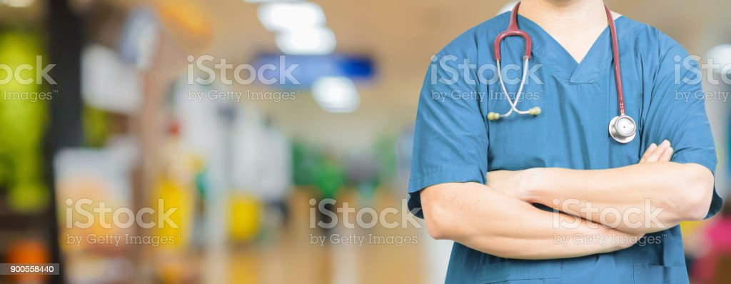 Medical ,Doctor surgeon posing with arms crossed in an operating theatre,surgical room,doctor with operating room,healthcare and medical concept,stethoscope,medical,healtcare ,background banner stock photo