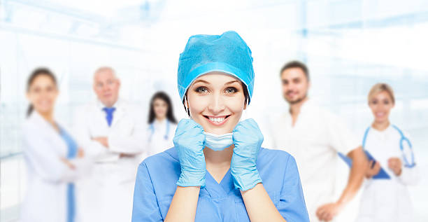 medical doctor surgical woman excited smile with team group medical doctor surgical woman excited smile with team group of people in hospital, nurse wear blue surgery suit gloves mask cap surgical cap stock pictures, royalty-free photos & images
