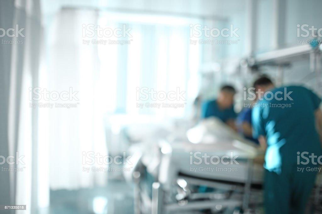Team Arzt am Krankenbett des Patienten, unscharfen Hintergrund – Foto