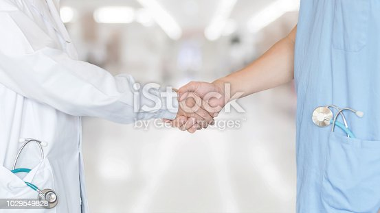 istock Medical doctor teamwork, surgeon, anesthetist, ER surgery team hand shaking in hospital clinic for  professional cooperative clinical work and collaboration on patient care operation concept 1029549828