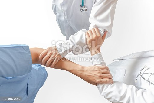 istock Medical doctor teamwork, surgeon, ER surgery clinical team hand group (isolated with clippig path) in hospital clinic for professional cooperative work on patient care operation concept 1028670022